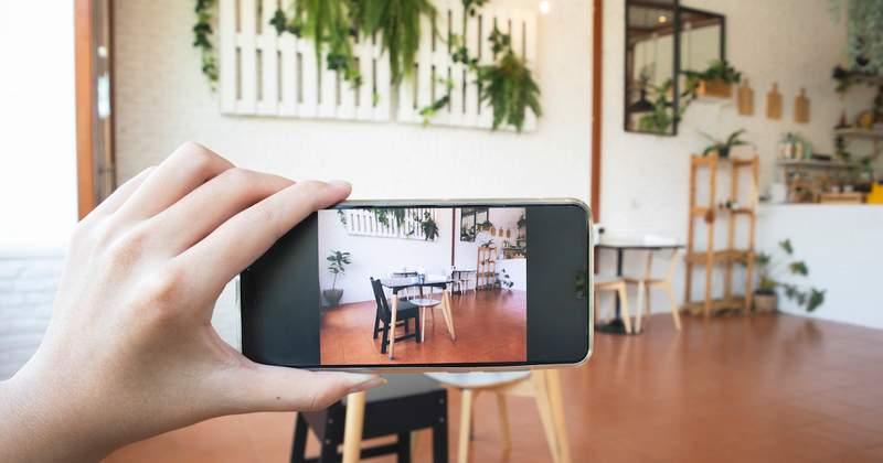 Woman taking photo of kitchen table