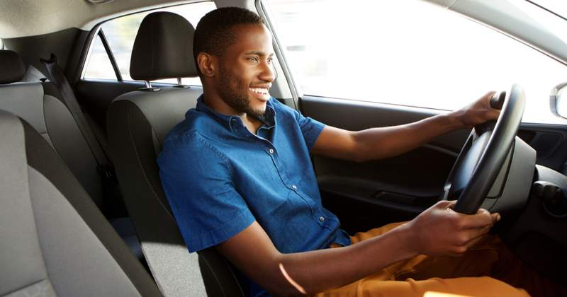 Smiling man sitting in the driver's seat